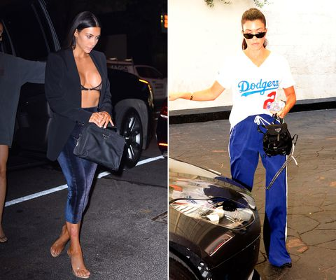 Kim and Kourtney Kardashian with Prada handbags